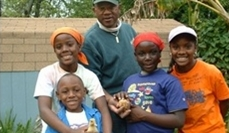 WISR student, Shyaam Shabaka, with youth at EcoVillage Farm